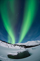 Aurora borealis over the Koyukuk river basin in the Brooks Mountain Range, Alaska