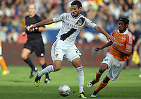 CARSON, CA - DECEMBER 01, 2012:   Tommy Meyer (21) of the Los Angeles Galaxy controls the ball in front of Calen Carr (3)of the Houston Dynamo during the 2012 MLS Cup at the Home Depot Center, in Carson, California on December 01, 2012. The Galaxy won 3-1.