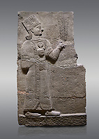 Picture & image of Hittite relief sculpted orthostat stone panel of Long Wall Basalt, Karkamıs, (Kargamıs), Carchemish (Karkemish), 900-700 B.C. Anatolian Civilisations Museum, Ankara, Turkey<br /> <br /> Goddess Kubaba. Goddess is depicted from the profile. She holds a pomegranate in her hands on her chest. She carries a one-horned headdress on her head. Her braided hair hangs down to her shoulder . <br /> <br /> On a gray background.
