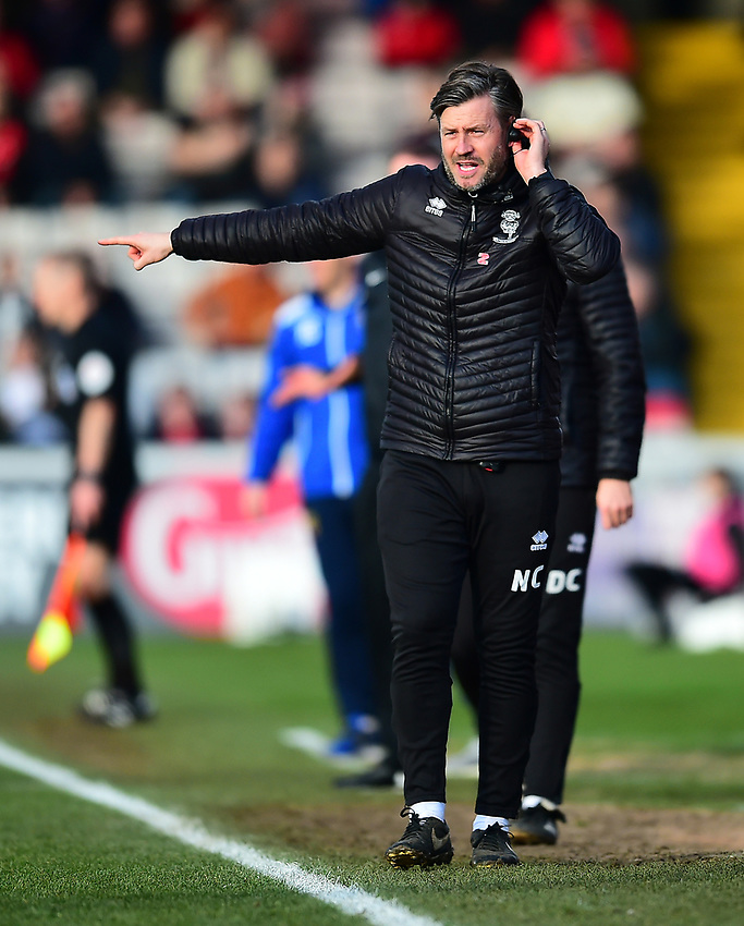 Lincoln City's assistant manager Nicky Cowley shouts instructions to his team from the technical area<br /> <br /> Photographer Andrew Vaughan/CameraSport<br /> <br /> The EFL Sky Bet League Two - Lincoln City v Stevenage - Saturday 16th February 2019 - Sincil Bank - Lincoln<br /> <br /> World Copyright © 2019 CameraSport. All rights reserved. 43 Linden Ave. Countesthorpe. Leicester. England. LE8 5PG - Tel: +44 (0) 116 277 4147 - admin@camerasport.com - www.camerasport.com