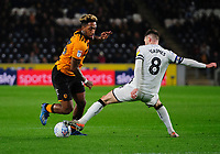 Hull City's Mallik Wilks vies for possession with Swansea City's Matt Grimes<br /> <br /> Photographer Chris Vaughan/CameraSport<br /> <br /> The EFL Sky Bet Championship - Hull City v Swansea City -  Friday 14th February 2020 - KCOM Stadium - Hull<br /> <br /> World Copyright © 2020 CameraSport. All rights reserved. 43 Linden Ave. Countesthorpe. Leicester. England. LE8 5PG - Tel: +44 (0) 116 277 4147 - admin@camerasport.com - www.camerasport.com