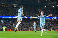 Kevin De Bruyne (17) of Manchester City runs to celebrates with goalscorer Ilkay Gundogan of Manchester City as he scores his 2nd goal and makes it 3 1 during the UEFA Champions League match between Manchester City and Barcelona at the Etihad Stadium, Manchester, England on 1 November 2016. Photo by Andy Rowland / PRiME Media Images.