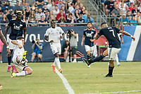 FOXBOROUGH, MA - JULY 27:  Dillon Powers #5 intercepts a shot on goal  by Gustavo Bou #7 at Gillette Stadium on July 27, 2019 in Foxborough, Massachusetts.