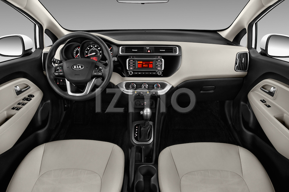 Stock photo of straight dashboard view of 2016 KIA Rio LX-AT 4 Door Sedan Dashboard