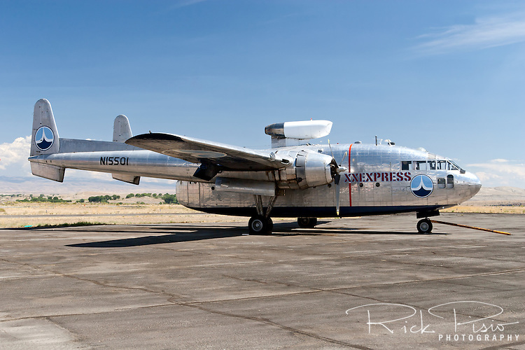 """The movie star of the Hawkins and Powers fleet sits on the tarmac in Greybull, Wyoming prior to auction in August of 2006. C119 Flying Boxcar N15501 was used to film the opening sequences of the remake of the movie """"Flight of the Phoenix."""""""