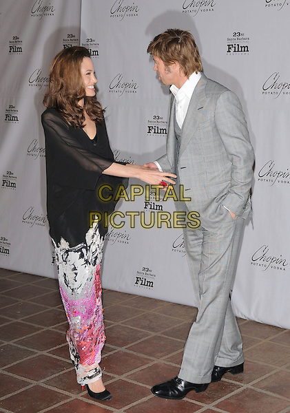 ANGELINA JOLIE & BRAD PITT.attend The 23rd Santa Barbara International Film Festival's Presentation of The Performance of the Year Award honoring Angelina Jolie held at The Arlington Theatre in Santa Barbara, California, USA, February 02 2008..full length grey gray suit jacket waistcoat black sheer dress shirt top  and couple pink print white patterned skirt long maxi pregnant shoes red ring hand.CAP/DVS.?Debbie VanStory/Capital Pictures