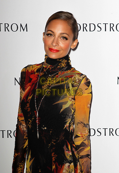 Nicole Richie<br /> Nicole Richie hosts grand opening of Nordstrom at The Americana at brand to benefit Ascencia And Hillsides held at Nordstrom at The Americana at Brand, Glendale, California, USA.<br /> September 17th, 2013<br /> half length yellow black red pattern print dress high collar long sleeves  <br /> CAP/ADM/KB<br /> &copy;Kevan Brooks/AdMedia/Capital Pictures