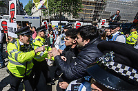 Kurds protesting against a state visit by  Erdogan the Turkish Prime Minister scuffle with police when some right wing Turkish protesters show up. There were several arrests at the police struggled to contain the situation. 15-5-18