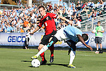 14 November 2010: Maryland's Jason Herrick (left) and North Carolina's Eddie Ababio (right). The University of Maryland Terrapins defeated the University of North Carolina Tar Heels 1-0 at WakeMed Soccer Park in Cary, North Carolina in the ACC Men's Soccer Tournament Championship game.