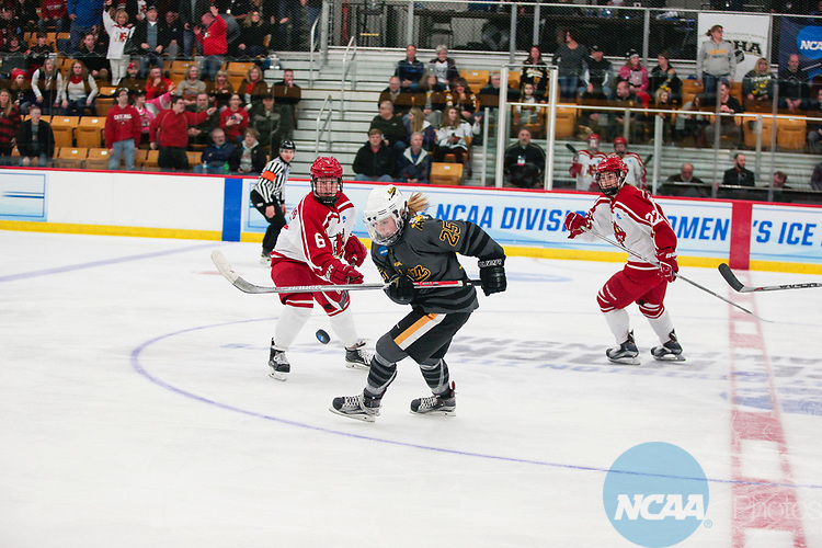 ADRIAN, MI - MARCH 18: Maci Hoskins (6) of Plattsburgh State University follows the puck with Kristin Lewicki (25) of Adrian College during the Division III Women's Ice Hockey Championship held at Arrington Ice Arena on March 19, 2017 in Adrian, Michigan. Plattsburgh State defeated Adrian 4-3 in overtime to repeat as national champions for the fourth consecutive year. by Tony Ding/NCAA Photos via Getty Images)