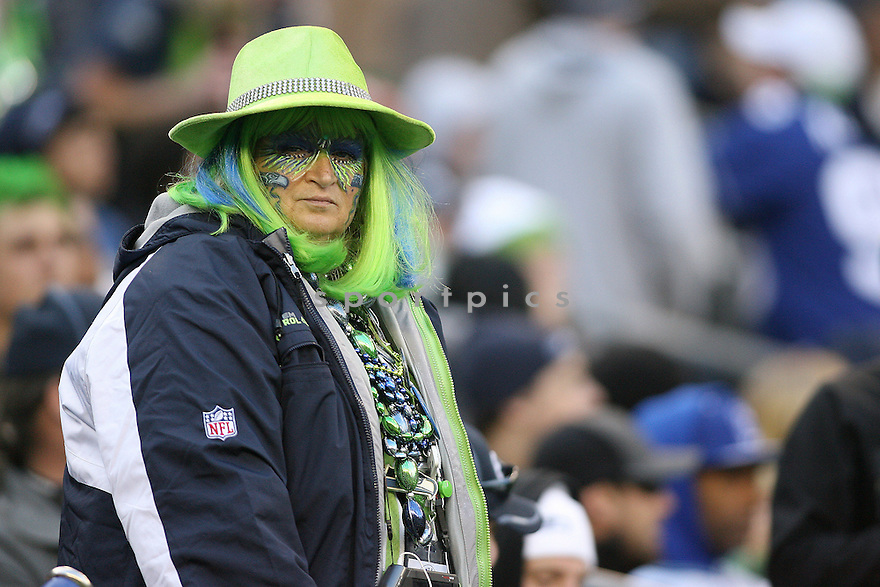 November 07, 2010:  Seattle Seahawks fans watch from the front row  against the New York Giants at Quest Field in Seattle, WA.  New York won 41-7 over Seattle.