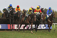 No Loose Change ridden by R Walsh (yellow cap) in jumping action during the Kettle Chips Handicap Chase