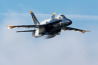 Blue Angels Lead Solo flown by  Lcdr Brandon Kempler passes approaches the airshow box during the sneak pass manuever.
