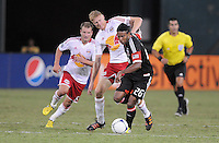 D.C. United Lionard Pajoy (26) goes against New York Red Bulls defender Markus Holgersson (5) The New York Red Bulls tied D.C. United 2-2 at RFK Stadium, Wednesday August 29, 2012.