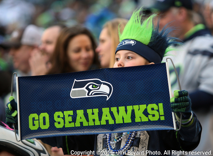 A Seattle Seahawks fan holds a sign as he watches the offensive unit go against the San Francisco 49ers at CenturyLink Field in Seattle, Washington on November 22, 2015.  The Seahawks beat the 49ers 29-13.   ©2015. Jim Bryant Photo. All RIghts Reserved.