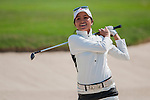 Ai-Chen Kuo of Chinese Taipei plays a shot during the Hyundai China Ladies Open 2014 on December 09 2014 at Mission Hills Shenzhen, in Shenzhen, China. Photo by Xaume Olleros / Power Sport Images