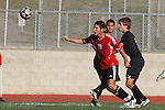 Palos Verdes, CA 02/03/12 - Chase Abelson (Peninsula #7) and Michael Meissner (Palos Verdes #10) in action during the Peninsula vs Palos Verdes boys varsity soccer game.