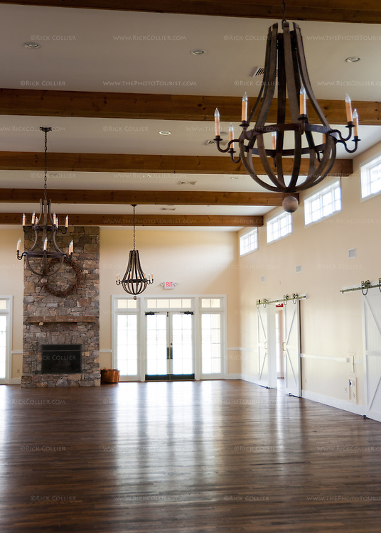 "The enormous event hall at King Family Vineyards includes a working fireplace and tasteful lighting in a rustic ""wine hall"" theme."
