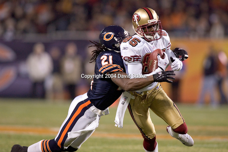 Defensive back R.W. McQuarters #21 of the Chicago Bears tackles wide receiver Brandon Lloyd #85 of the San Francisco 49ers at Soldier Field on October 31, 2004 in Chicago, Illinois. The Bears defeated the Niners 23-13. (Photo by David Stluka)