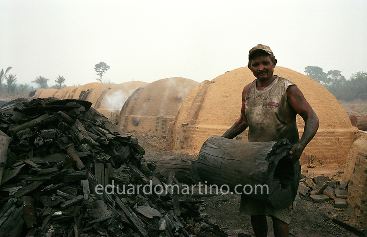 Modern-day Slavery in Brazil<br /> A worker at a charcoal producing farm on the edge of the Amazon rainforest. The Ministry of Labour's grupo movel (mobile unit), who work to end the use of unfree labour in the region, are developing a pioneering activity to assign responsibility for the slavery cases reported on such farms to the pig iron producing companies, as the charcoal is made to be sold exclusively to these extremely profitable companies.