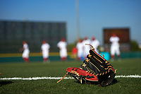 Baseball glove sits on the field as the Florida Fire Frogs warmup before a game against the Daytona Tortugas on April 6, 2017 at Osceola County Stadium in Kissimmee, Florida.  Daytona defeated Florida 3-1.  (Mike Janes/Four Seam Images)