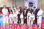 Killarney Mayor Michael Gleeson cuts the tape with a sword to officially open the Killarney Martial Arts Academy on Saturday morning .