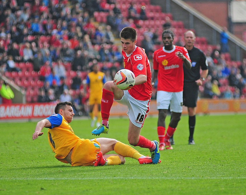 Crewe Alexandra's Liam Nolan is fouled by Preston North End's Bailey Wright <br /> <br /> Photographer Chris Vaughan/CameraSport<br /> <br /> Football - The Football League Sky Bet League One - Crewe Alexandra v Preston North End - Saturday 03rd May 2014 - Alexandra Stadium - Crewe<br /> <br /> &copy; CameraSport - 43 Linden Ave. Countesthorpe. Leicester. England. LE8 5PG - Tel: +44 (0) 116 277 4147 - admin@camerasport.com - www.camerasport.com