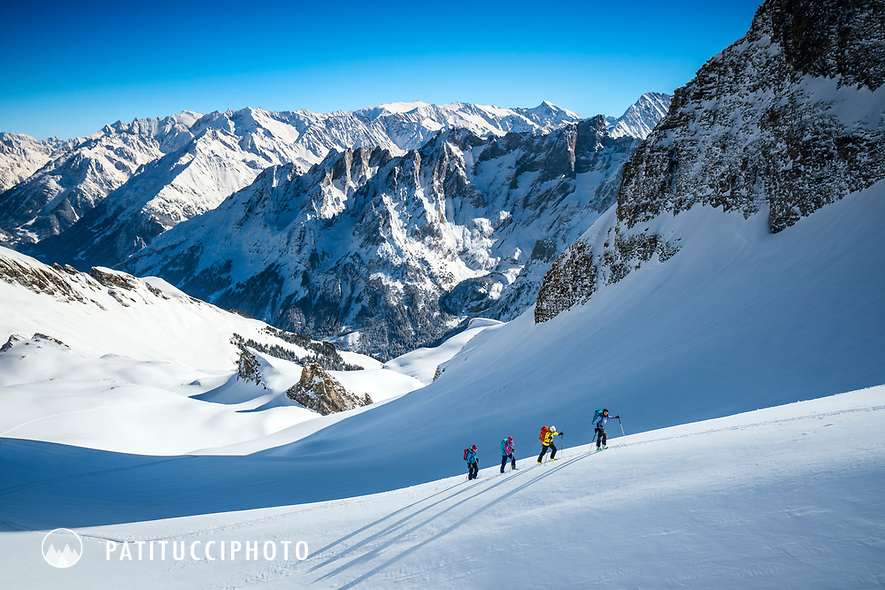 Ski touring beneath the Schwarzhorn with the Engelhorner in the distance, above Rosenlaui, Switzerland