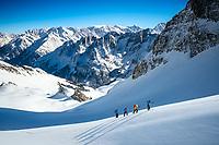 Ski touring beneath the Schwarzhorn with the Engelhorner in the distance, above Rosenlaui, Switzerland