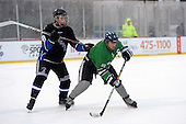 Notre Dame Fighting Irish of Batavia defensemen Dylan Cory (21) sets up in front of Wyatt Johnson (8) during a varsity ice hockey game against the Brockport Blue Devils during the Section V Rivalry portion of the Frozen Frontier outdoor hockey event at Frontier Field on December 22, 2013 in Rochester, New York.  (Copyright Mike Janes Photography)