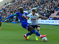8th February 2020; DW Stadium, Wigan, Greater Manchester, Lancashire, England; English Championship Football, Wigan Athletic versus Preston North End; Cedric Kipre of Wigan Athletic tackles Sean Maguire of Preston North End