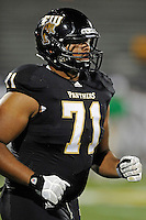 1 September 2011:  FIU offensive lineman Caylin Hauptmann (71) waits for play to resume late in the game as the FIU Golden Panthers defeated the University of North Texas, 41-16, at FIU Stadium in Miami, Florida.