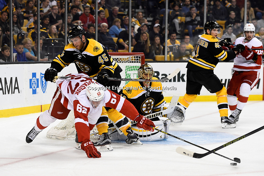 Monday, September 28, 2015, Boston, MA - Detroit Red Wings right wing Zach Nastasiuk (62) is checked by Boston Bruins defenseman Joe Morrow (45) as he reaches for the puck in front of goalie Tuukka Rask (40) during the NHL game between the Detroit Red Wings and the Boston Bruins held at TD Garden, in Boston, Massachusetts. Detroit defeats Boston 3-1 in regulation time. Eric Canha/CSM