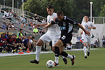 19 May 2012: Carolina's Austin King (15) and PSA Elite's Christian Ramirez (left). The Carolina RailHawks (NASL) defeated the PSA Elite (USASA) 6-0 at WakeMed Soccer Stadium in Cary, NC in a 2012 Lamar Hunt U.S. Open Cup second round game.