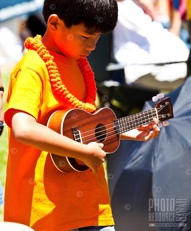 Little boy playing ukulele at the 40th Annual Ukulele Festival at Kapiolani Park