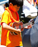 Little boy playing ukulele at the 40th Annual Ukulele Festival at Kapiolani Park