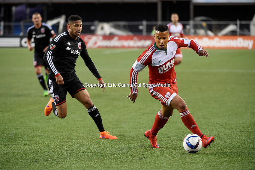 May 23, 2015 - Foxborough, Massachusetts, U.S. - New England Revolution forward Charlie Davies (9) works the ball in front of D.C. United defender Sean Franklin (5) during the MLS game between DC United and the New England Revolution held at Gillette Stadium in Foxborough Massachusetts. The New England Revolution and D.C. United ended the game tied 1-1.  Eric Canha/CSM