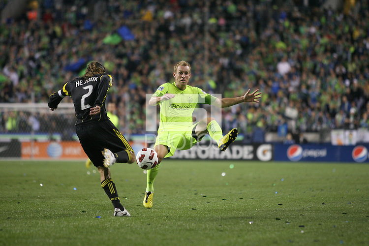 Tyson Wahl (5)of the Seattle Sounders FC blocks the kick of Frankie Hejduk (2) of the Columbus Crew. The Seattle Sounders FC defeated the Columbus Crew 2-1 during the US Open Cup Final at Qwest Field in Seattle,WA, on October 5, 2010.