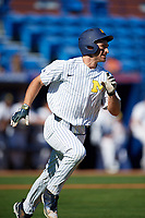 Michigan Wolverines center fielder Jonathan Engelmann (2) runs to first base during a game against Army West Point on February 18, 2018 at Tradition Field in St. Lucie, Florida.  Michigan defeated Army 7-3.  (Mike Janes/Four Seam Images)