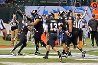 20 December 2011:  FIU wide receiver T.Y. Hilton (4) celebrates his first-quarter touchdown with offensive lineman Caylin Hauptmann (71), quarterback Wesley Carroll (13), and others as the Marshall University Thundering Herd defeated the FIU Golden Panthers, 20-10, to win the Beef 'O'Brady's St. Petersburg Bowl at Tropicana Field in St. Petersburg, Florida.