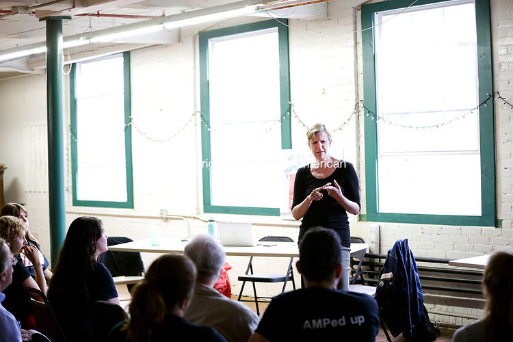 Winsted, CT- 07 August 2017-080717CM01-  Michelle Begley, Development and Programming at American Mural Project makes remarks at Whiting Mills Studio in Winsted on Monday.  Apprentices who worked with the mural project celebrated the completion of its pilot Digital Storytelling Internship program by talking about the experience and showing off videos they created.      Christopher Massa Republican-American