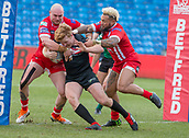 10th February 2019, AJ Bell Stadium, Salford, England; Betfred Super League rugby, Salford Red Devils versus London Broncos; James Cunningham of London Broncos is caught behind his lines by Gil Dudson and Junior Sa'u of Salford Red Devils