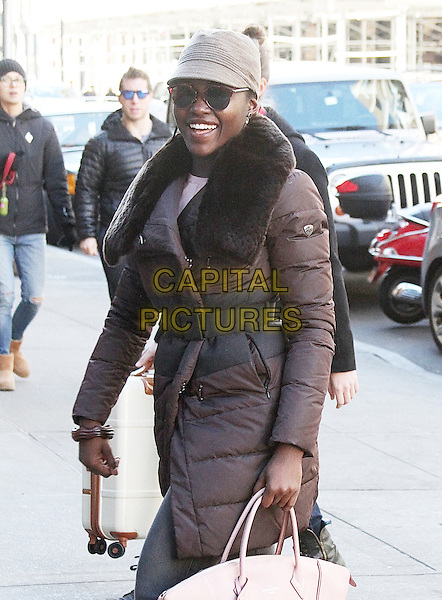 New York, NY - November 29: Lupita Nyong'o arrives at The Public Theatre for the last day of her performance in 'Eclipsed' on November 29, 2015 before the play goes to Broadway in February 2016. <br /> CAP/MPI/RMP<br /> &copy;RMP/MPI/Capital Pictures
