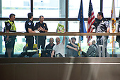 "United States Capitol Police prepare to arrest protestors chanting ""Healthcare is a right"" outside the office of United States Senator Lisa Murkowski (Republican of Alaska) in the Hart Senate Office Building in Washington, DC on Wednesday, June 28, 2017.<br /> Credit: Ron Sachs / CNP"