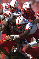 21 October 2006:  N.C. State DTs DeMarcus Tank Tyler (72) and  DeMario Pressley (92) stop the Maryland RB behind the line of scrimmage.  The Maryland Terapins defeated the N.C. State Wolfpack 26-20 October 21, 2006 at Chevy Chase Bank Field at Byrd Stadium in College Park, MD..