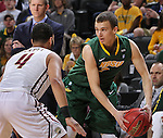 SIOUX FALLS, SD - MARCH 6:  Paul Miller #2 of North Dakota State looks to pass against defender Jordan Pickett #4 of IUPUI in the 2016 Summit League Tournament.  (Photo by Dick Carlson/Inertia)