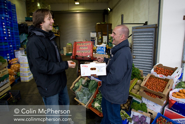 Nick Evans (right), a fruit and vegetable wholesaler pictured at his stall at the  Old Meat Market in Liverpool, north-west England with local chef Tom Gill, one of his regular clients. The daily market caters for wholesale and individual customers from across the region.