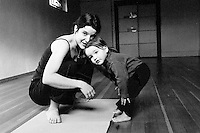 Mothers Portrait #2.Yoga teacher Amy Agnello teaches her18-month old daughter some animal poses.
