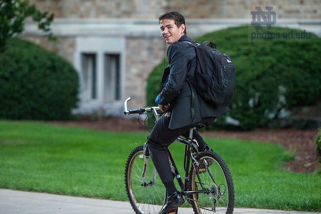 Sept. 10, 2015; Tom Paulius, senior Engineering major from suburban Chicago, bikes to campus on Career Fair day. (Photo by Matt Cashore/University of Notre Dame)
