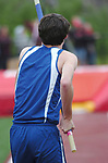 A pole vaulter prepares for his jump.